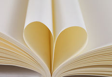 Heart from a book page Stock Photos