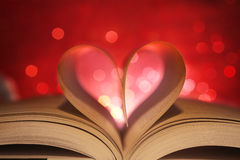Heart in book pages. Book pages in the shape of a heart stock photo