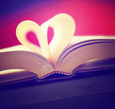 Heart from book pages toned with a retro vintage instagram filt Stock Photography