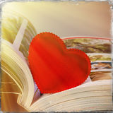 Heart and book Stock Images