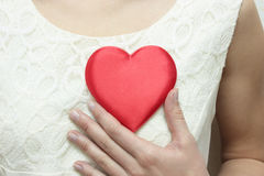The Heart on bosom. Stock Photo
