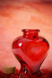 Heart bottle. A heart-shaped glass Valentine's bottle stock images
