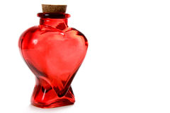 Heart bottle. A heart-shaped glass Valentine's bottle stock photos