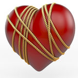 Heart Bound With Golden Rope Royalty Free Stock Photos