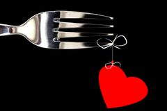 Heart bow on black. Fork and heart royalty free stock photography