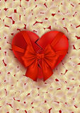 Heart with bow and rose petals Royalty Free Stock Photography