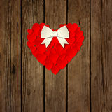 Heart with a bow on a wooden background vector Royalty Free Stock Image
