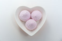 Heart bowl in pink marshmallows. White background, in a white bowl of pink masmellow royalty free stock image