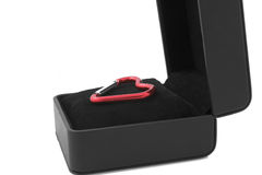 Heart in the box. Red heart keyring lying in the black gift box Stock Image