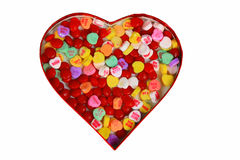 Heart box of candy. Heart box of a variety of red and sugary candy Stock Image