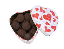 Heart box with chocolate truffles Stock Images
