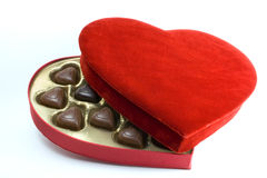 Heart box with chocolates. Red velvet heart shaped box with chocolates Stock Images
