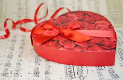 Heart box of chocolates over classic music notes Stock Image
