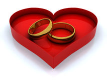 Heart box and golden rings Stock Photography