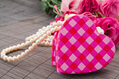 Heart box with pearls and flowers. Pink heart shaped box with pearls and flowers stock photos
