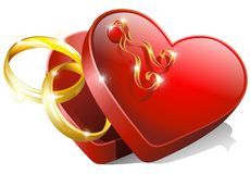 Heart Box with Wedding Rings. Wedding Rings on a Red Heart Box Stock Photos