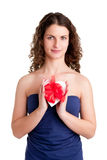 Heart in a Box. Woman holds a heart shaped box with her hands, isolated in white Royalty Free Stock Images
