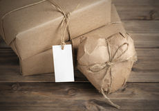 Heart and box wrapped in brown kraft paper Stock Image