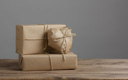 Heart and box wrapped in brown kraft paper Royalty Free Stock Photos