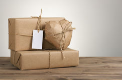 Heart and box wrapped in brown kraft paper Stock Images