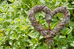 Heart braided from straw and willow rods Royalty Free Stock Photography