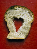 Heart in bread Stock Images