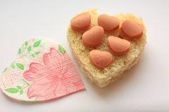 The heart of the bread, hearts of sausages. Stock Image
