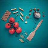 Heart of bread and tomatoes with nuts and leaves Stock Photo
