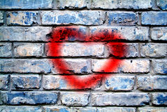 Heart on a brick wall Stock Images