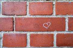 Heart on brick wall Royalty Free Stock Photography