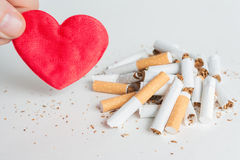 Heart and broken cigarettes. Quit smoking Royalty Free Stock Photography