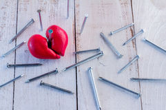 Heart broken with nail Stock Photo