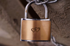 Heart on bronze padlock Stock Image
