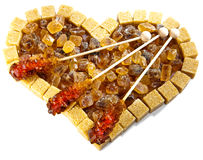 Heart from brown candy sugar and sugar on  stick Royalty Free Stock Photo