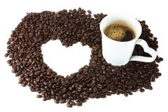Coffee cup. Heart brown coffee beans texture frame with white coffee cup Stock Photo