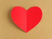 Heart on brown paper background Royalty Free Stock Images