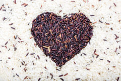 Heart Brown rice on center Stock Photography
