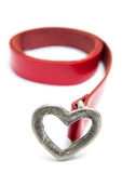 Heart buckle belt. Red belt with heart metal buckle isolated on white Stock Image