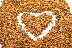 Heart on buckwheat groats. The drawn heart on buckwheat groats. A background. Shallow DOF Royalty Free Stock Images