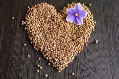 Heart from buckwheat groats royalty free stock photos