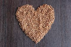 Heart from buckwheat groats stock photography