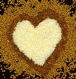 Heart from buckwheat and rice Royalty Free Stock Photo