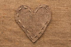 Heart  of  burlap, lies on a background of burlap Royalty Free Stock Photography