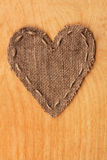 Heart  of  burlap, lies on a background of wood Royalty Free Stock Photography
