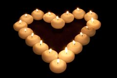 Heart of burning candles Royalty Free Stock Photos