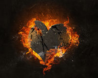 Heart burning in fire Royalty Free Stock Image