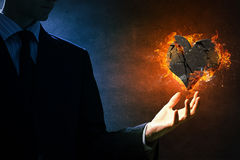 Heart burning in fire Royalty Free Stock Images