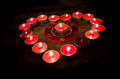 Heart burns with love for Valentine's Day. A heart of fire of love burning red candles Royalty Free Stock Photo