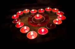 Heart burns with love for Valentine's Day. A heart of fire of love burning red candles Royalty Free Stock Images