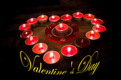 Heart burns with love for Valentine's Day. A heart of fire of love burning red candles Stock Photos